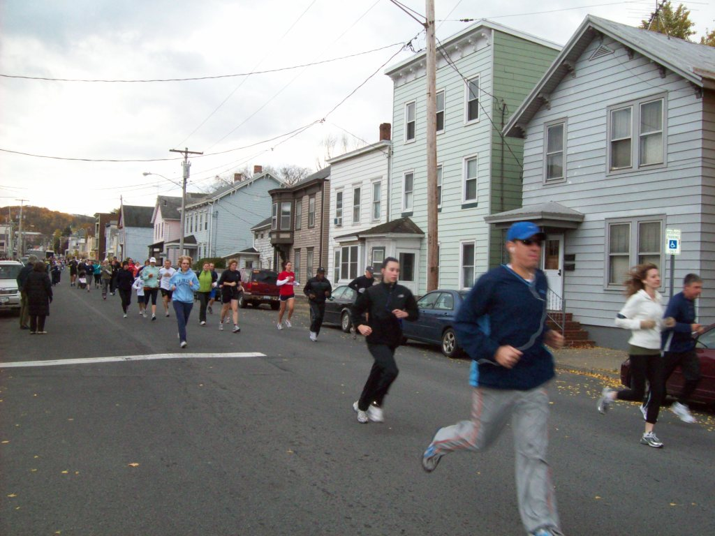 Runners at the beginning of the Ghostly Gallop 5k race at the Hudson Area Library