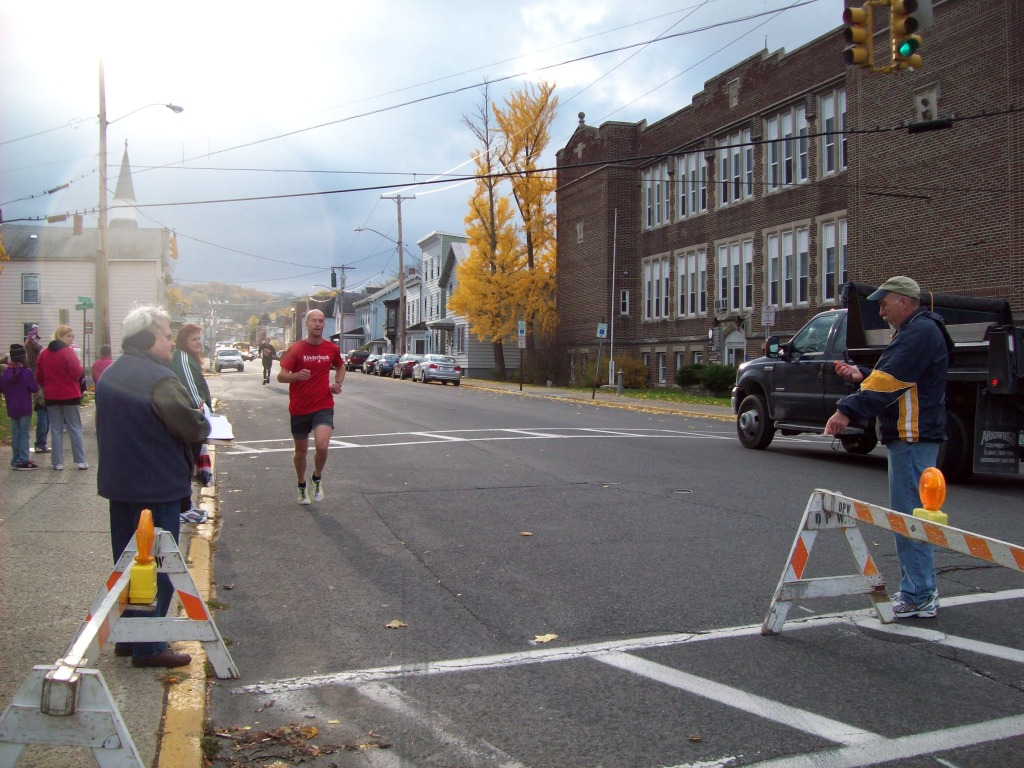 Rowland Butler finishes the Ghostly Gallop 5k race at the Hudson Area Library in Hudson NY 12534