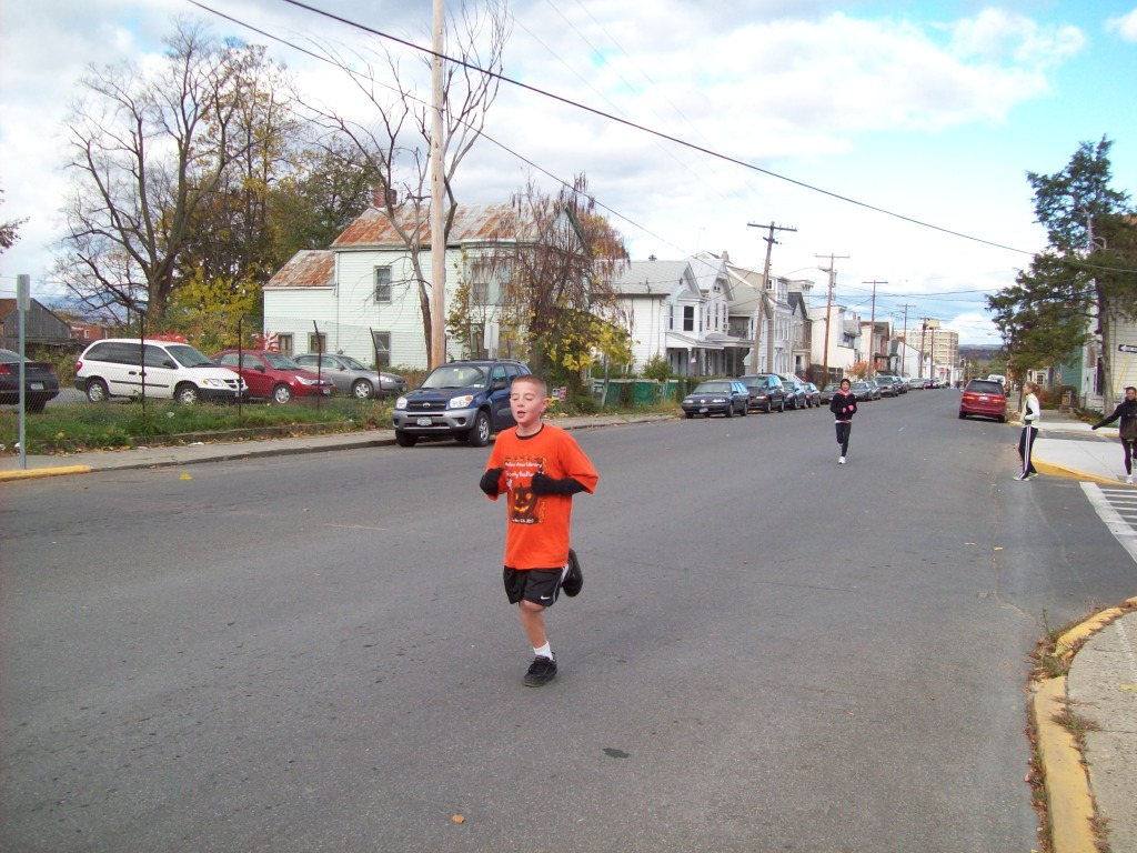 Jarid Neal finishes the Kids Mile Run in front of the Hudson Area Library Hudson NY