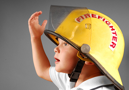 Young boy in Fireman's Helmet