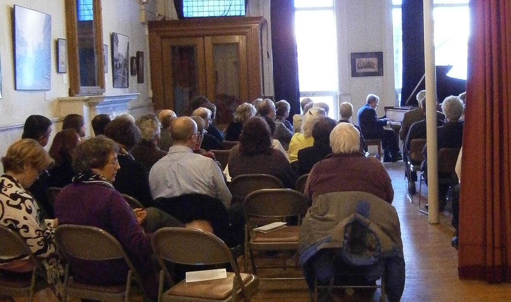 Library supporters listened attentively to well-loved classics played by pianist Morey Hall.