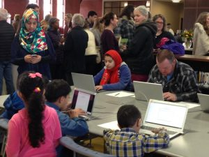 library users use the library's Chromebooks on opening day